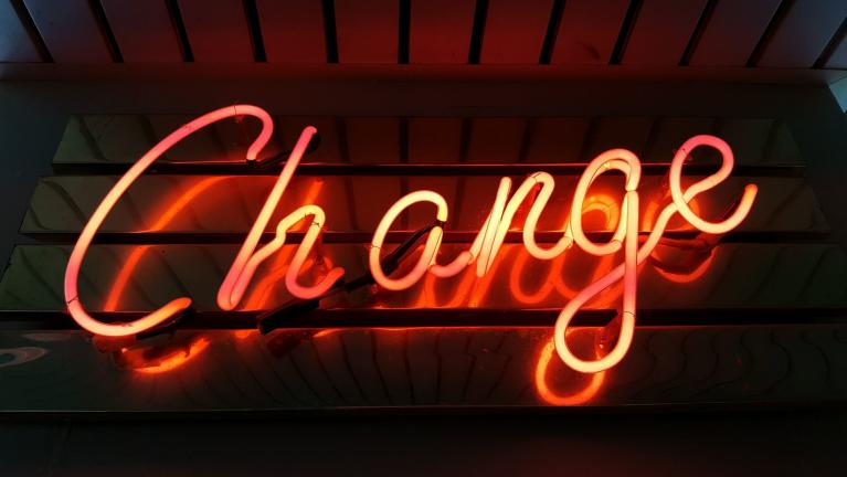 "The word ""Change"" in neon"